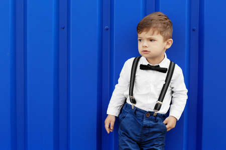 Adorable little boy on blue background