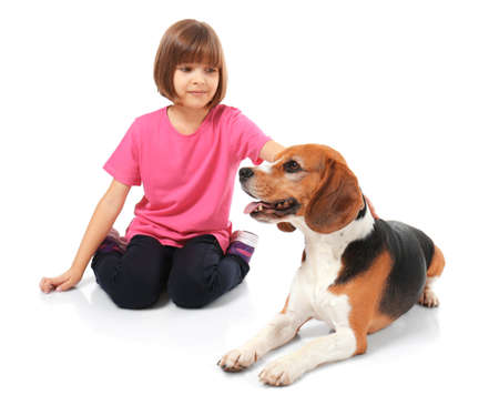 Cute little girl with dog on white background 스톡 콘텐츠