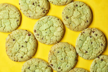 Mint chocolate chip cookies on yellow background