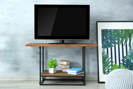 Modern TV set on stand in living room Stock Photo