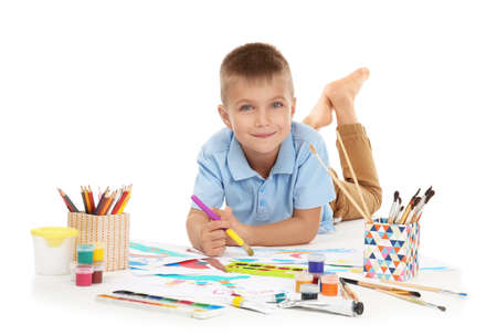 Cute little boy painting against white background Stock Photo