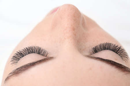 Young woman with eyelash extensions, closeup Stock Photo