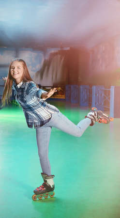 Charming teenage girl at roller skating rink
