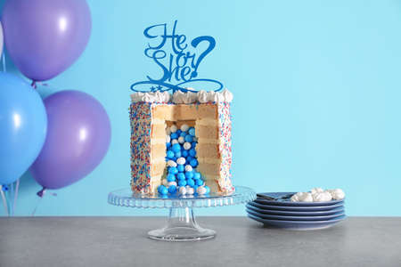 Tasty cake for baby shower party on table