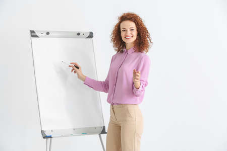 Business trainer giving presentation on whiteboard Stock Photo