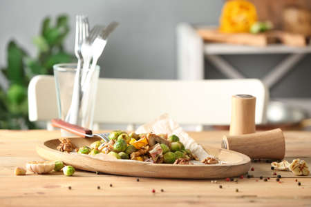 Plate with yummy brussel sprouts salad on wooden table Stock Photo