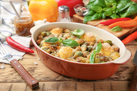 Tasty casserole with brussels sprouts in baking dish on table Stock Photo