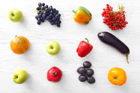 Ripe fruits, vegetables and berries on light background