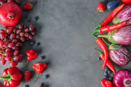 Composition of different fruits and vegetables on grey background Standard-Bild