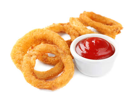 Fried breaded onion rings with ketchup on white background Stock Photo