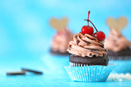 Tasty cupcake for Valentine's Day on blue table Foto de archivo
