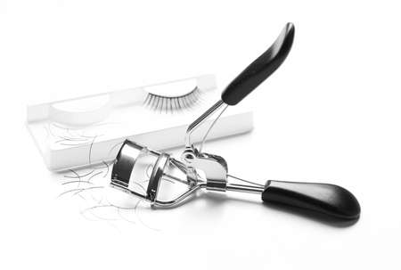 Curler and false eyelashes on white background Stock Photo