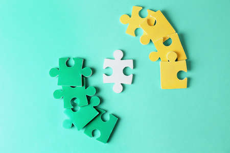 Composition with different puzzles on color background. Concept of autism Stock Photo