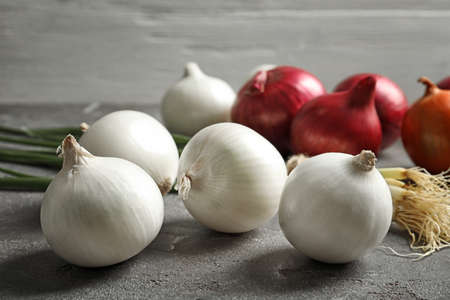 Different fresh onions on table