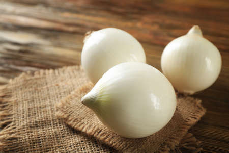 Ripe white onions on table