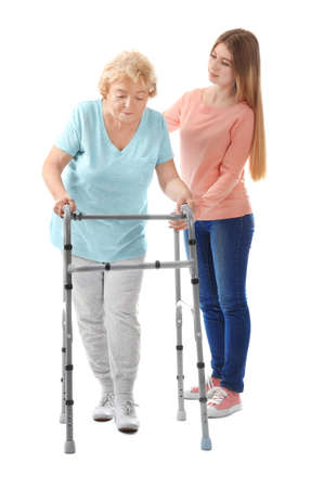 Young Woman And Her Elderly Grandmother With Walking Frame On ...
