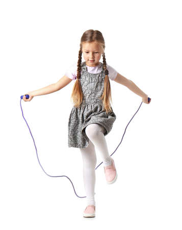 Cute little girl playing with jumping rope on white background Reklamní fotografie