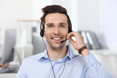 Male consulting manager with headset in office