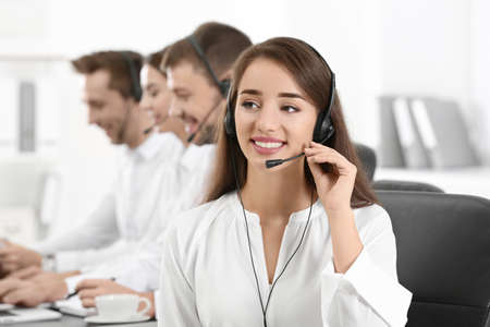 Female consulting manager with headset in office