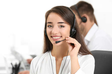 Female consulting manager with headset in office Stock Photo