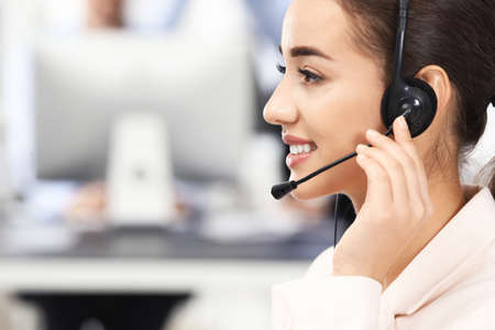 Female consulting manager with headset in office 版權商用圖片
