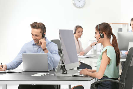 Consulting managers with headsets in office