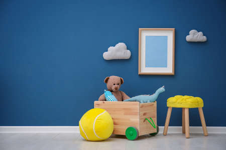 Children's room with bright color wall, interior details Stock Photo - 98990574
