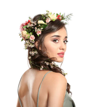 Beautiful young woman with flower wreath on white background Stock Photo