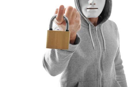 Hacker in mask holding lock on white background