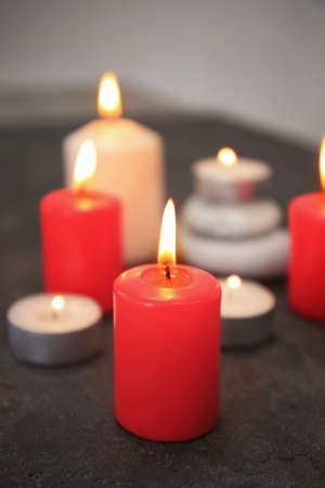 Burning candles on table