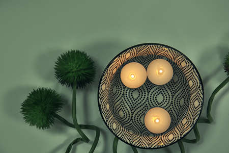 Composition with burning candles on light background