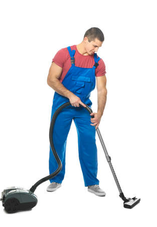 Young man with vacuum cleaner on white background