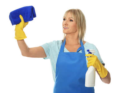 Mature woman with bottle of detergent and rag on white background