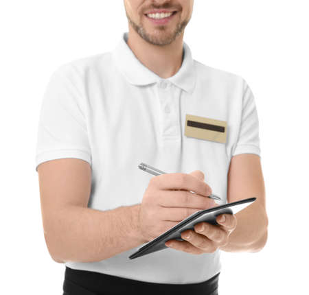 Handsome waiter writing down order, on white background Фото со стока