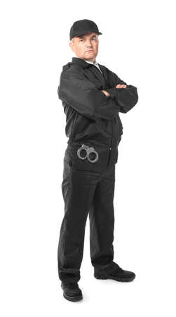 Male security guard standing on white background