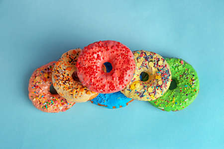 Tasty donuts on color background Stock Photo