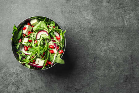 Bowl with fresh tasty salad on table Stock Photo