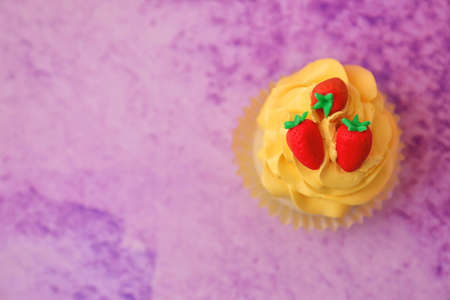 Tasty bright cupcake on color background Stock Photo