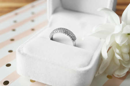 Box with luxury engagement ring on table, closeup Stock Photo