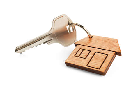 Key with trinket in shape of house on white background Stock Photo