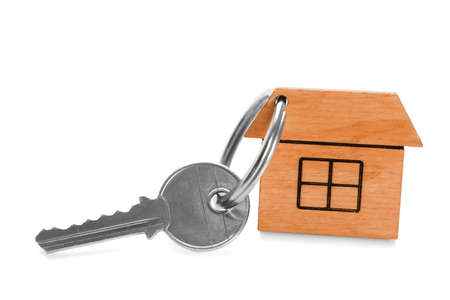 Key with trinket in shape of house on white background