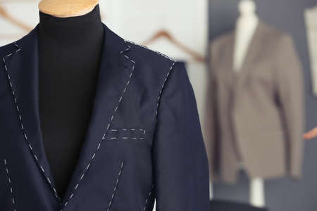 Tailors mannequin with half-made jacket in atelier Stock Photo