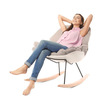 Young woman resting in rocking chair on white background