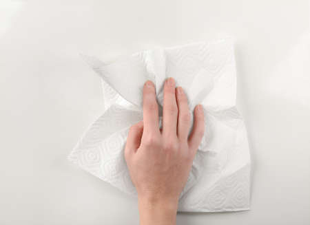 Hand of woman with paper towel on white background 版權商用圖片