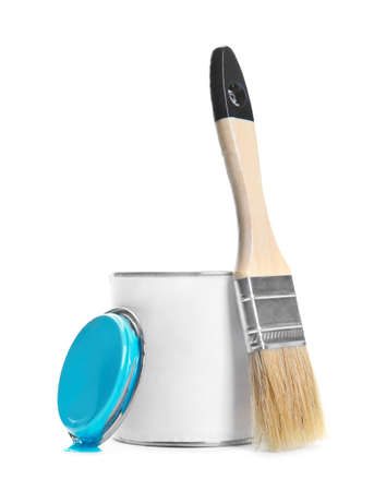 Can of blue paint and brush on white background