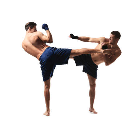 Attractive young kickboxers fighting on white background Stockfoto