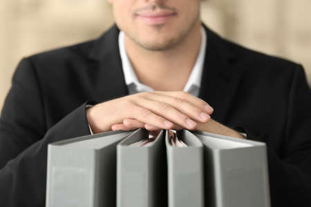 Young man with documents in office Stock Photo