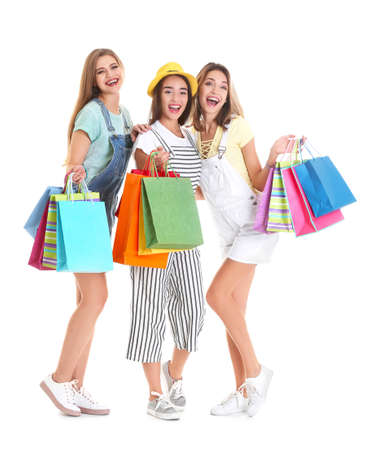 Happy young women with shopping bags on white background Stock Photo