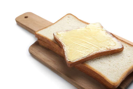 Board with tasty toasts and butter on white background, closeup Stock Photo