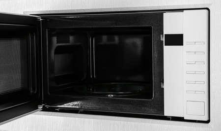 New white microwave oven in kitchen, closeup Reklamní fotografie